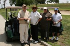 Adults playing golf
