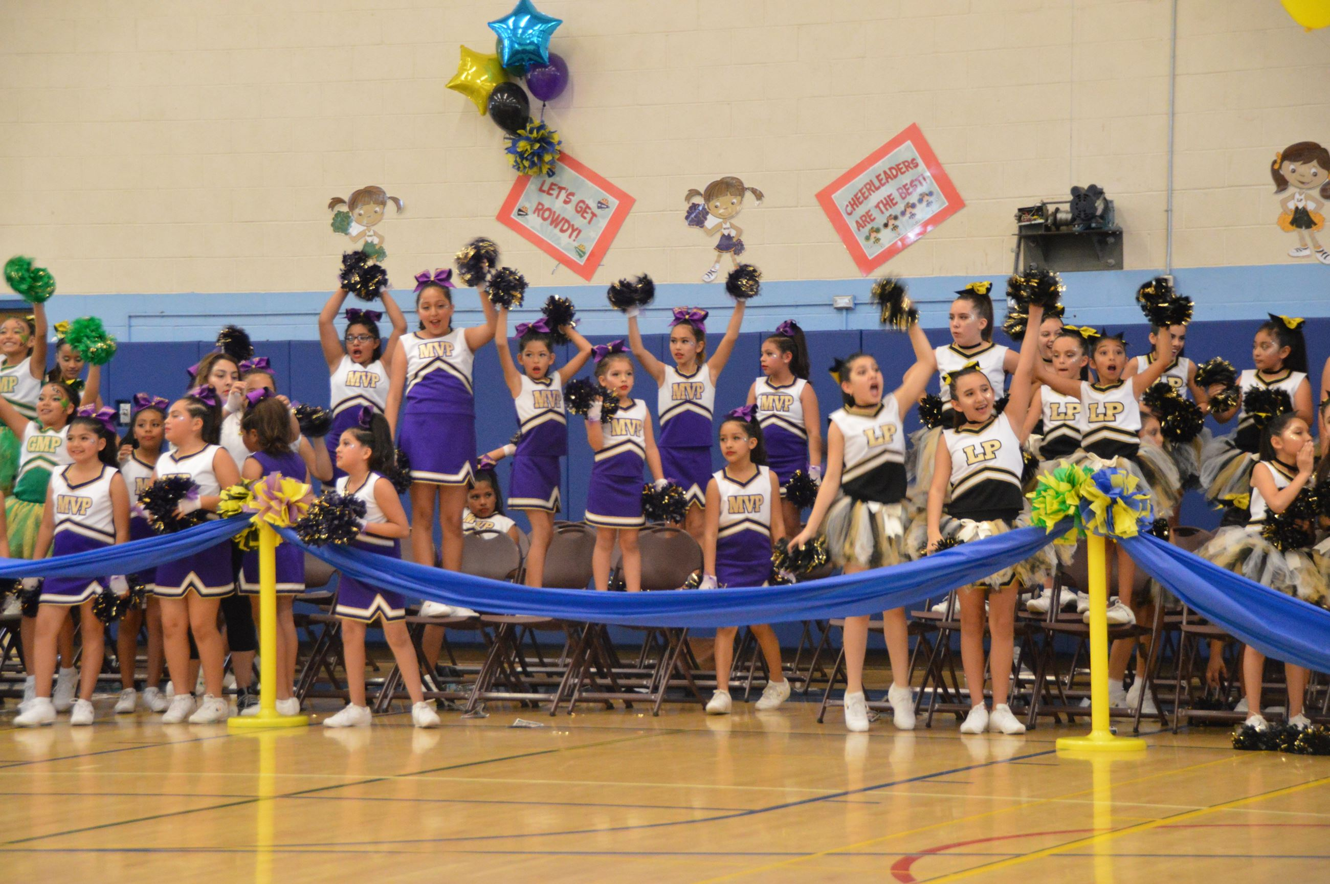 Group of Pee Wee Cheerleaders cheering at the annual Jamboree event